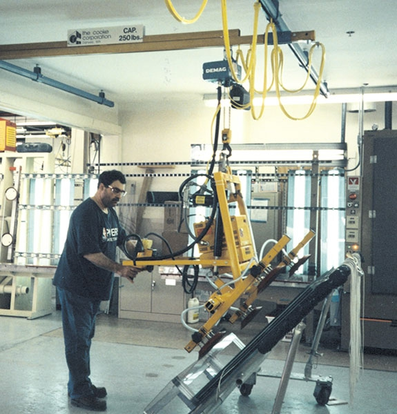 Vacuum lifter with electric powered tilt